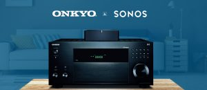 Onkyo AV Receiver on table in front of blue background living room with Onkyo and Sonos logos