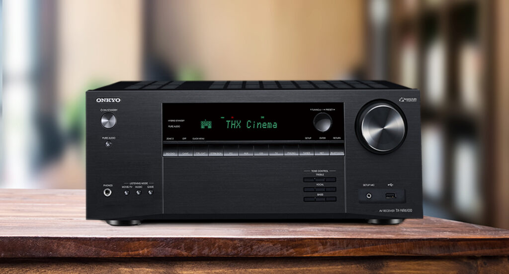 Onkyo TX-NR6100 AV Receiver On Wooden Table with Blurred background