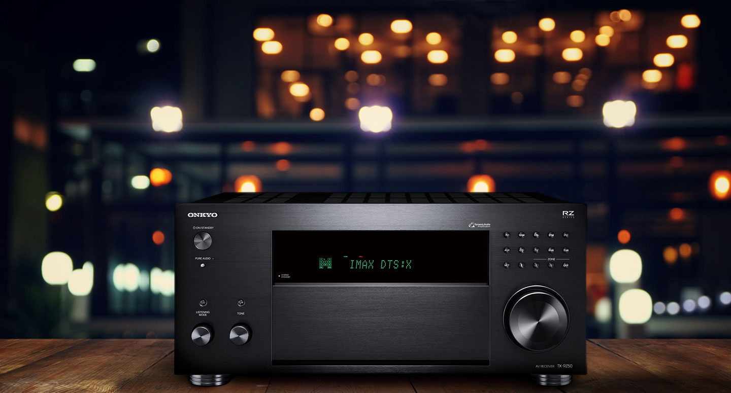 Onkyo TXRZ50 AV Receiver in bar area sitting on a wooden table with string lights in the background