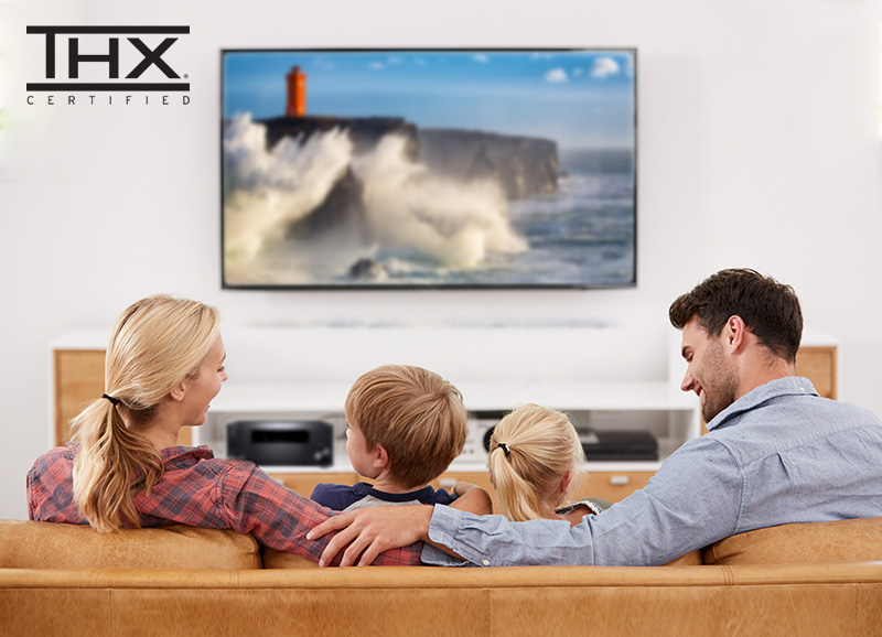 Onkyo AV Receiver under TV with family watching a movie and the THX Certified logo